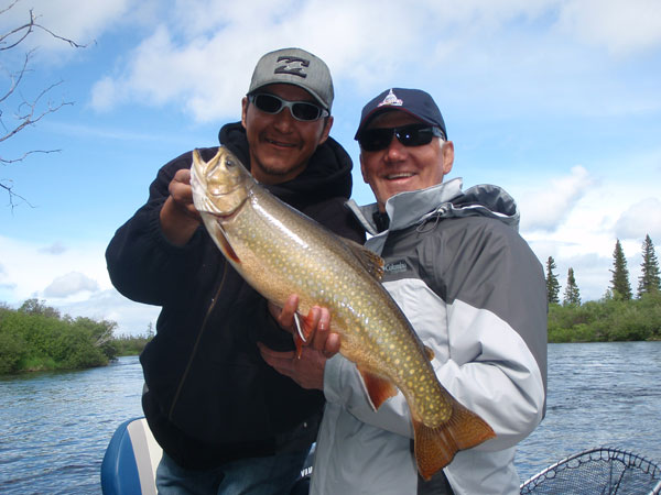 "Steve Havens and Jeffrey Andrews with a beautiful 23"" inch Brook Trout"